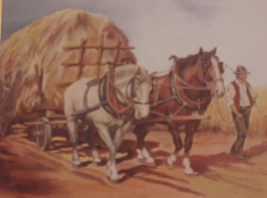 Chevaux et charrette de foin